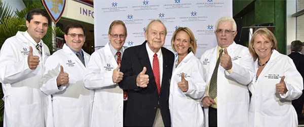 Dr. Alejandro Levy, Dr. Robert Sutphin, Dr. Don Eslin, Dr. Amy Smith, Dr. Vincent Giusti and Dr. Susan Kelly celebrate the exciting news with Arnold Palmer at Arnold Palmer Hospital.